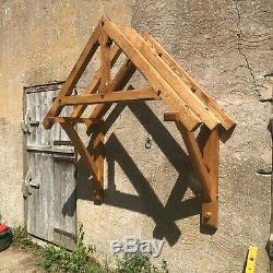 Green oak door canopy kit 1150 between gallows. Oak door porch. Self build porch